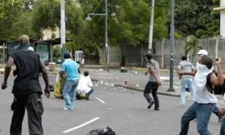 Suspenden clases en la UASD por disturbios en contra del apresamiento de Yimi Zapata
